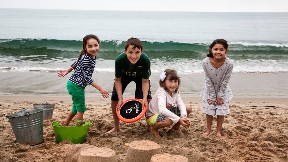 Kylie, Nathan, Devyn & Sophia on the beach at Malibu. © Mike Wong