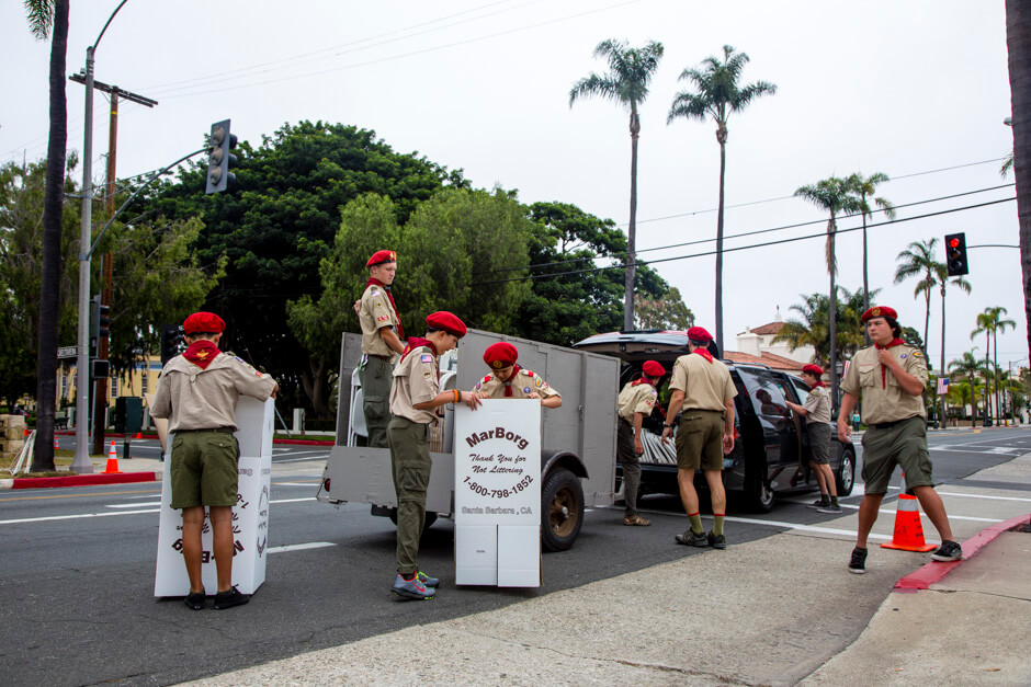 Nathan and other scouts from Troop 26 setting up for the Santa Barbara 4th of July parade.