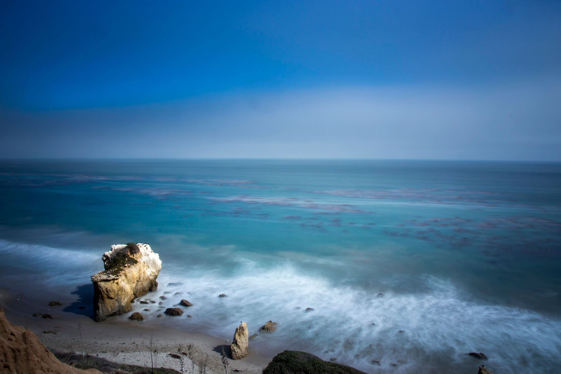 A long exposure photo looking down on El Matador beach in Malibu.