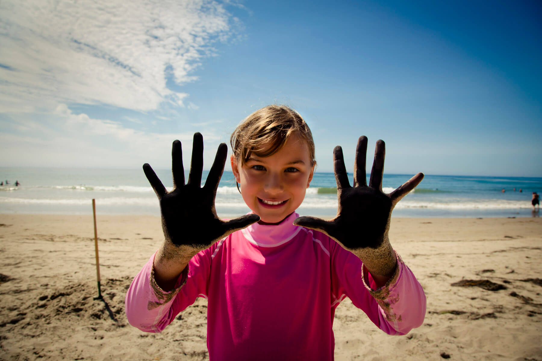 Devyn with her charcoal covered hands @ Haskell's Beach.